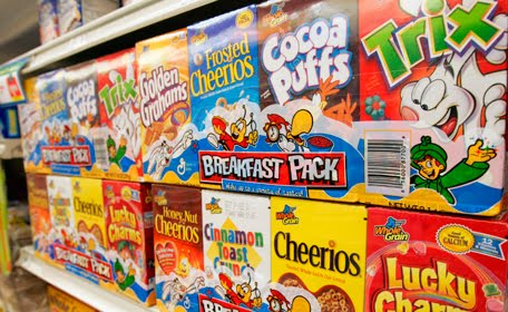 Addictive Flavors & Foods To Avoid, the cereal aisle in the grocery store