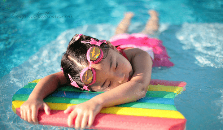 Protect Your Hide: 9 Of The Safest Sunscreens For Kids (& You), little girl lying in the sun on a raft, suntanning