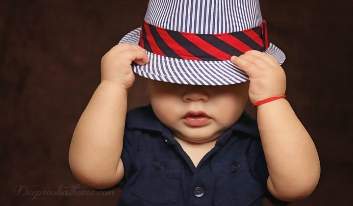 Parents Play Key Role Helping Kids Avoid Gender Confusion. A cute toddler with a snazzy men's hat covering his eyes.