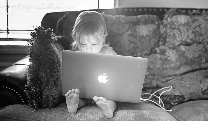 Child Harm, the Silent Tragedy: Every Parent who Cares Should Read This. A young child engrossed in a laptop device