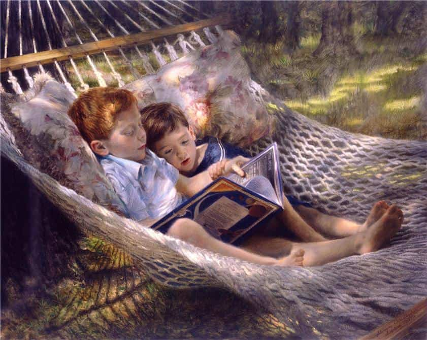 2 boys in a hammock reading