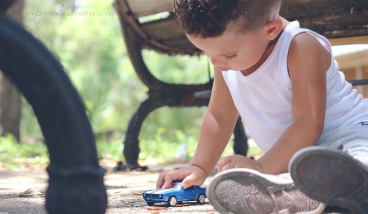 4 Crucial Brain Differences Between Boys & Girls: Why We Act & Think So Differently. A young boy playing with a blue Hot Wheels car.
