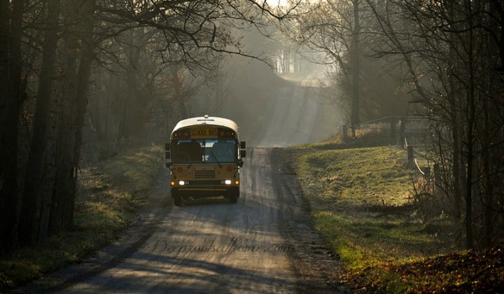 "Teachers Instructed On Student Privacy: ""Don't Tell The Parents!"" A yellow school bus coming down a country road."