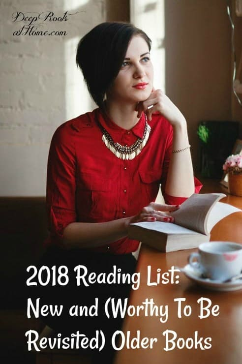 2018 Reading List: New and {Worthy To Be Revisited} Older Books. Black-haired woman in red blouse resting chin on her hand reading a thick book in a coffee shop.