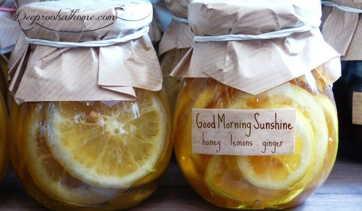 My 'Good-Morning-Sunshine' Drink: Honey & Lemons In Warm Water. Jars of prepared honeyed lemon slices, labeled