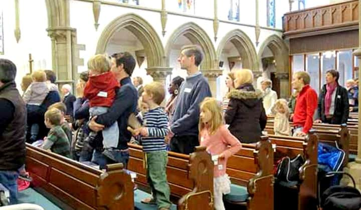 Should Children Be Sitting Through Worship In 'Big Church'? families with children worshiping in a church service