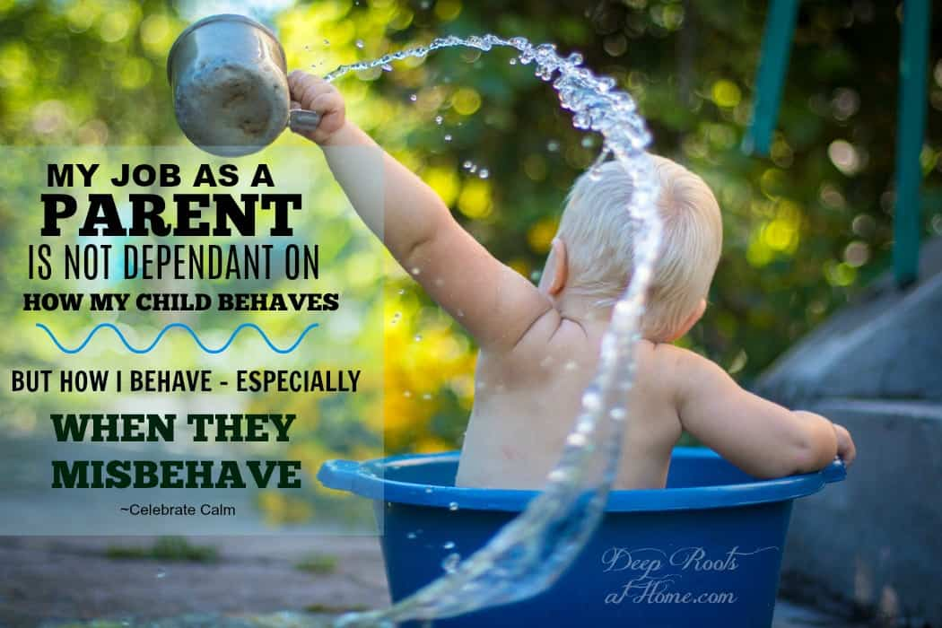 a little boy in bathtub splashing water