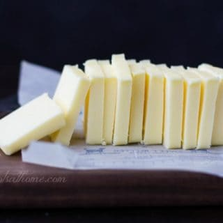 pats of yellow of butter on counter