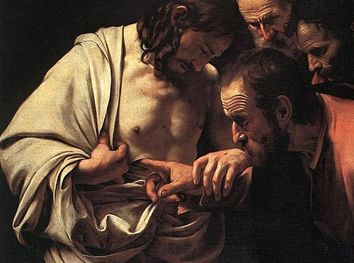 Thomas looking at Jesus's wound in his side.