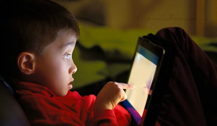 Screen Time, Digital Drug: Brain Images Show It's As Addictive As Opioids. A young boy, all alone, fixated on a screen