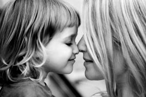 Connection For Keeps: Making The Most of The 900 Weeks Of Childhood. A mother and daughter touch noses
