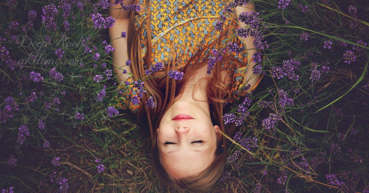 Self Love /Self Care: A Many-Faced Culture: A Young Woman's Warning. A smiling beautiful red-haired woman lying restfully on her back, eyes closed, in a field of lavender.