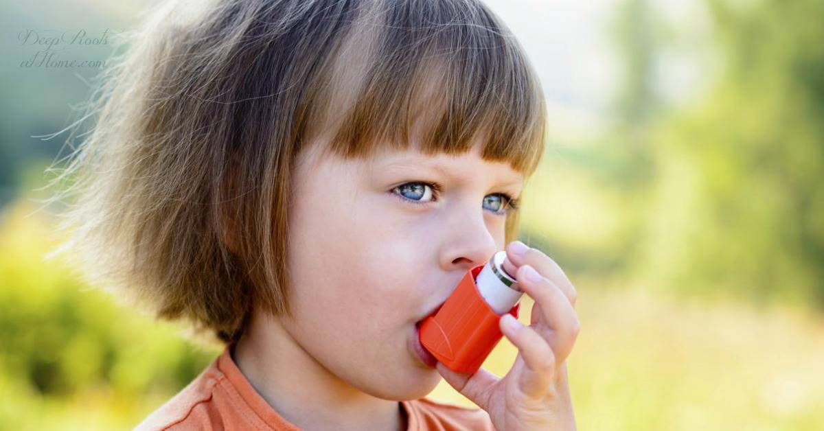 Study: Tylenol Even Once/Month Increases a Child's Asthma Risk 500%. A child with bangs and straight hair uses an inhaler outside on a summer day.