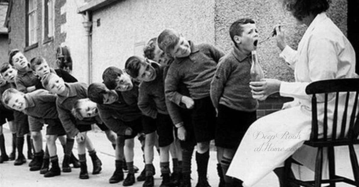 Evidence Fish or Cod Liver Oil Can Help Brain Processing Disorders, ADD. Old photo of school boys in Europe lined up, taking cod liver oil.