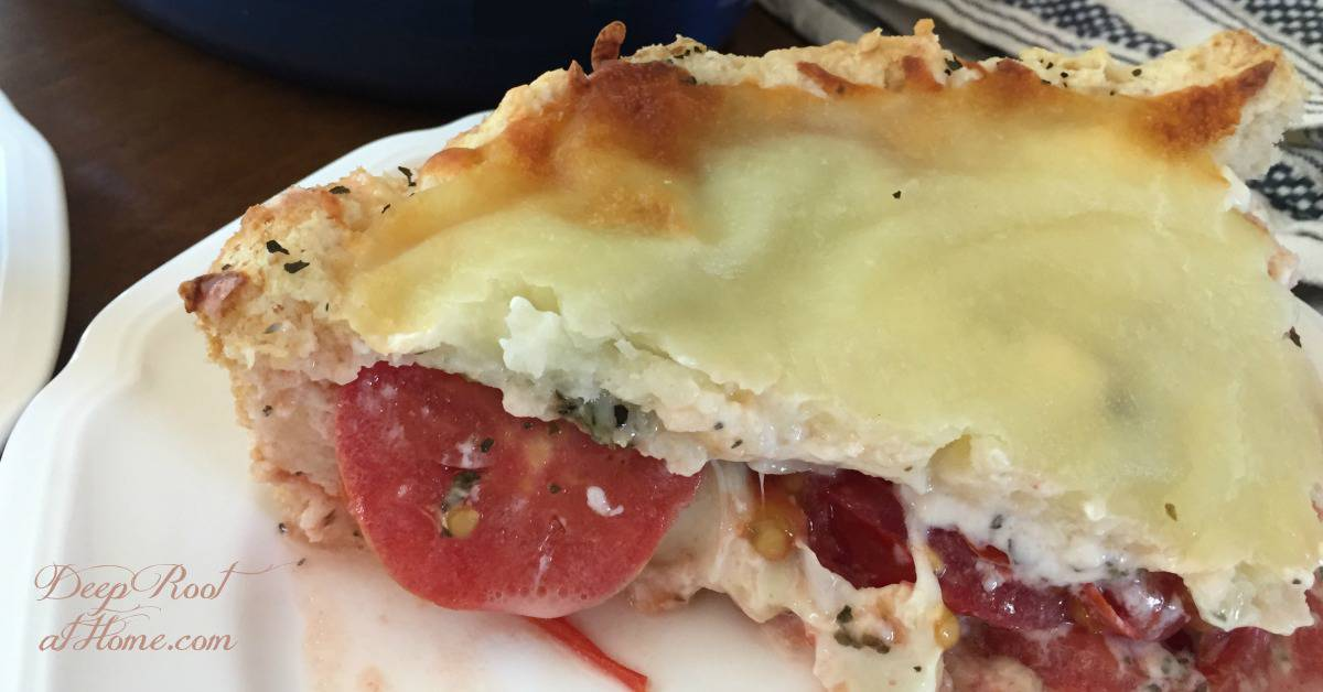 Olivia's Tomato Pie: Savory, Cheesy Summertime Favorite. A freshly cut slice of delectable summer tomato pie!