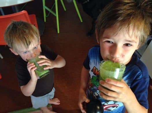 2 Cute young boys drinking Dr. Kilbane's PediaSure® alternative.