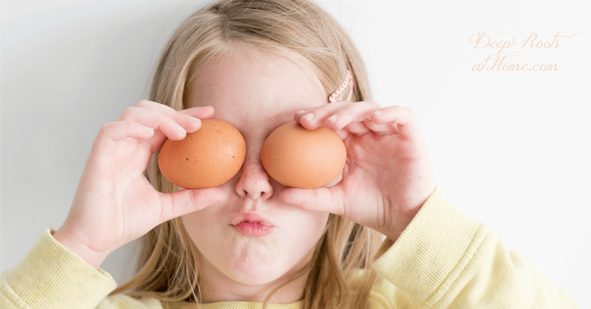 Eggs Are the Healthiest, Full-Range Nutritive Food on the Planet. A cute girl holding 2 eggs up to her eyes