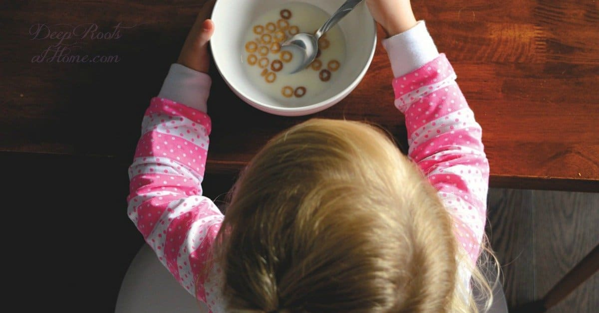 Glyphosate In Breakfast Foods Your Family May Eat. A pajama-clad toddler eating Cheerios.