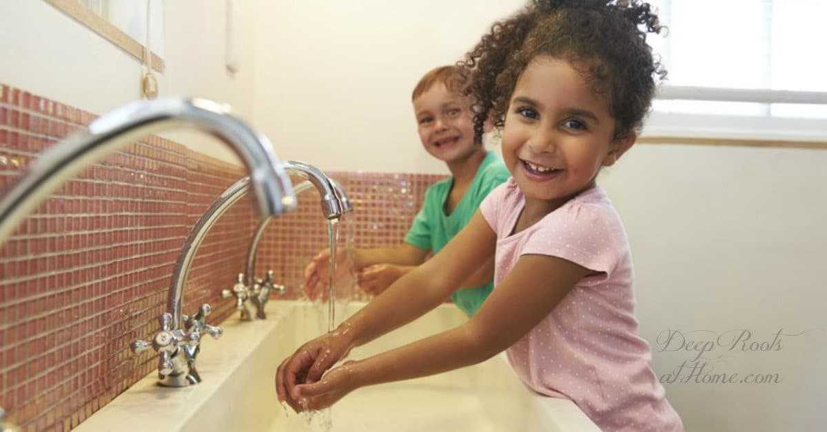 Handwashing (not sanitizer) & a Humidifier Lower Viruses In Flu Season. little children in bathroom