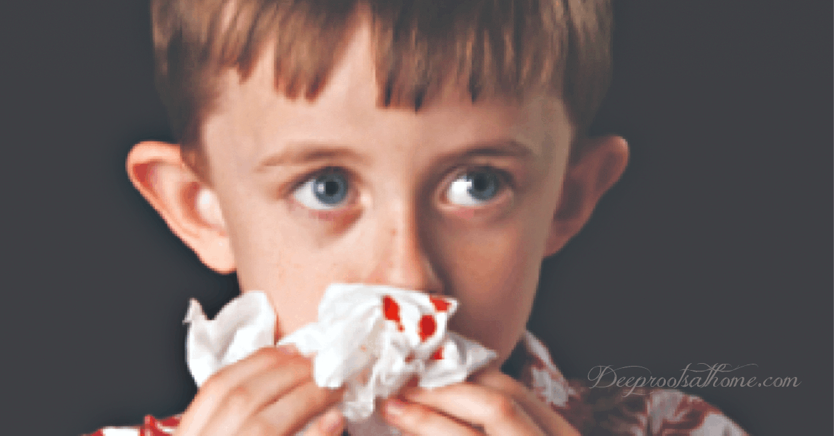 boy with a nosebleed